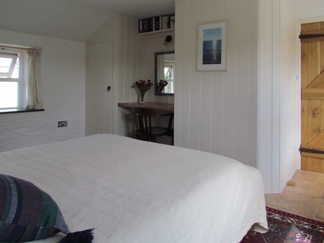 The main bedroom has a king size bed, built in wardrobe and dressing table with mirror